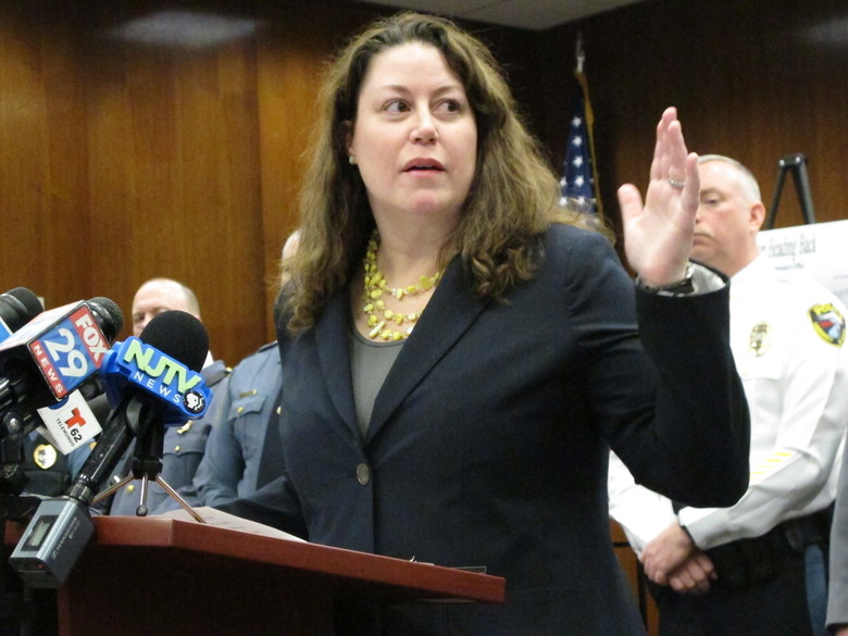 First New Jersey Assistant Attorney General Jennifer Davenport speaks at a press conference Friday, March 9, 2018, in Toms River, N.J., to announce drug charges against 31 people in New Jersey, New York and one foreign country that he would not identify. (AP Photo/Wayne Parry)