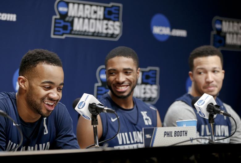 Villanova's Jalen Brunson right Mikal Bridges center and Phil Booth left chuckle as they take questions during a news conference at the NCAA men's college basketball tournament Friday
