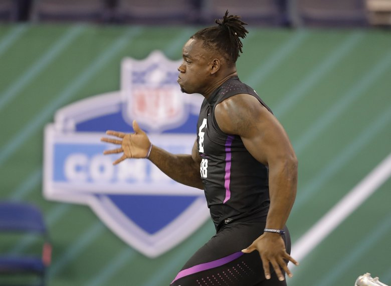 Washington running back Lavon Coleman runs the 40-yard dash at the NFL scouting combine. (AP Photo/Darron Cummings)