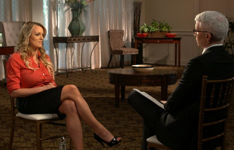 "This image released by CBS News shows Stormy Daniels, left, during an interview with Anderson Cooper which will air on Sunday, March 25, 2018, on ""60 Minutes."" (CBS News/60 Minutes via AP) NYET350 NYET350"