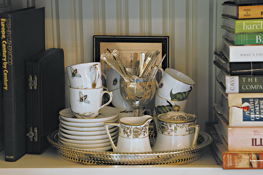 A tray is used to house teacups in this kitchen bookcase. (Mary Carol Garrity / TNS)