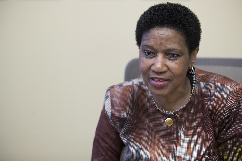 "Phumzile Mlambo-Ngcuka, United Nations Under-Secretary-General and Executive Director of U.N. Women, speaks during an interview with The Associated Press, Wednesday, March 7, 2018, in New York. The head of the U.N. agency promoting equality for women says the global spotlight on sexual harassment and abuse and the punishment of some powerful men who had been ""untouchable"" is an important moment — but it's just ""a tip of an iceberg.""  (AP Photo/Mary Altaffer)"
