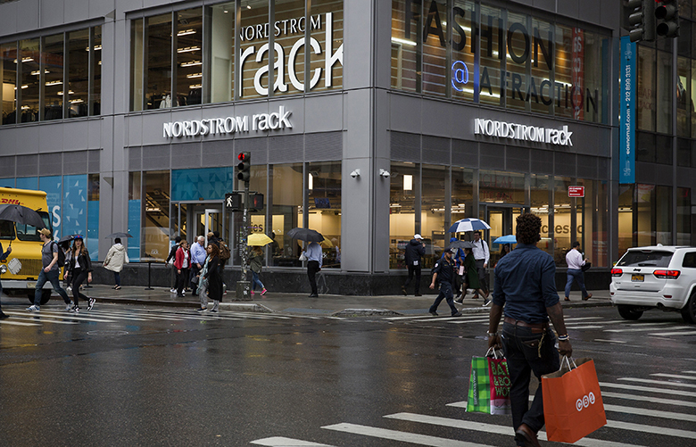 Pedestrians pass in front of a Nordstrom Rack store ahead of the grand opening in the Herald Square neighborhood of New York, U.S., on Tuesday, Oct. 24, 2017. The 47,000 square-foot location, which sprawls over three floors, comes ahead of the crucial holiday shopping period and as department stores fight for a shrinking base of customers that are increasingly focused on value. Photographer: Caitlin Ochs/Bloomberg