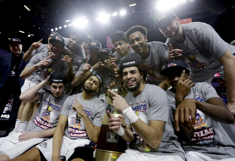 Gonzaga players celebrate after winning the West Coast Conference tournament championship on Tuesday in Las Vegas. The Zags beat Brigham Young 74-54 in the final. (Isaac Brekken/AP)