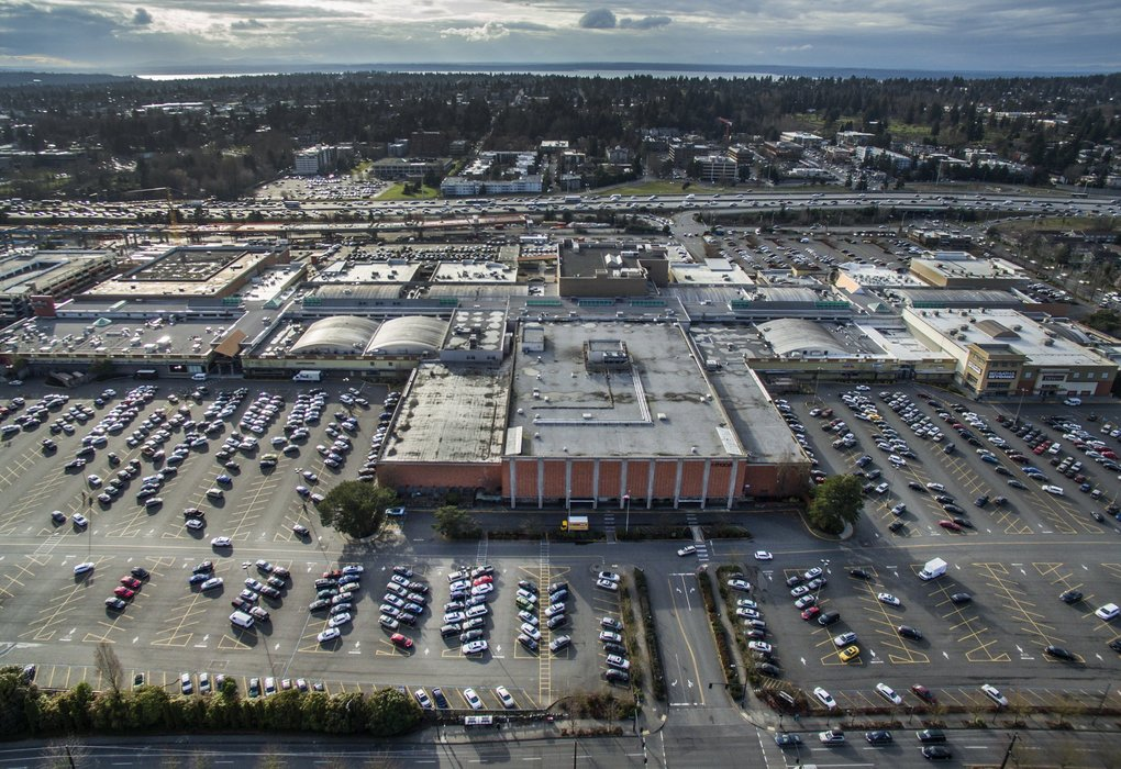 "New plans have been filed for ""a complete re-imagining of Northgate,"" according to its owner, that includes proposals for retail, offices, housing and a hotel on the property that spans about 55 acres. This drone photo is looking west over the mall. Interstate 5 is in the far distance. (Steve Ringman / The Seattle Times)"