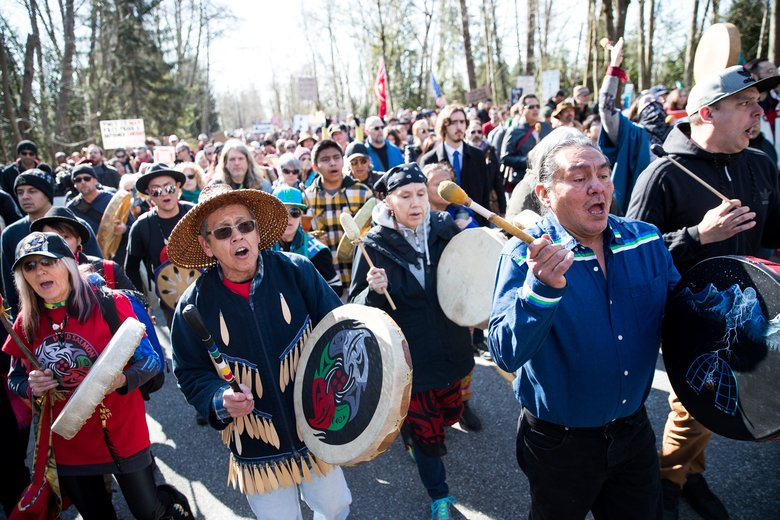 First Nations Tribal Member Eddie Gardner, left, and Chief Darrel Bob of the St'at'imc Nation, march with others in Saturday's demonstration against the Trans Mountain pipeline expansion in Burnaby, B.C. (Courtney Pedroza/The Seattle Times)