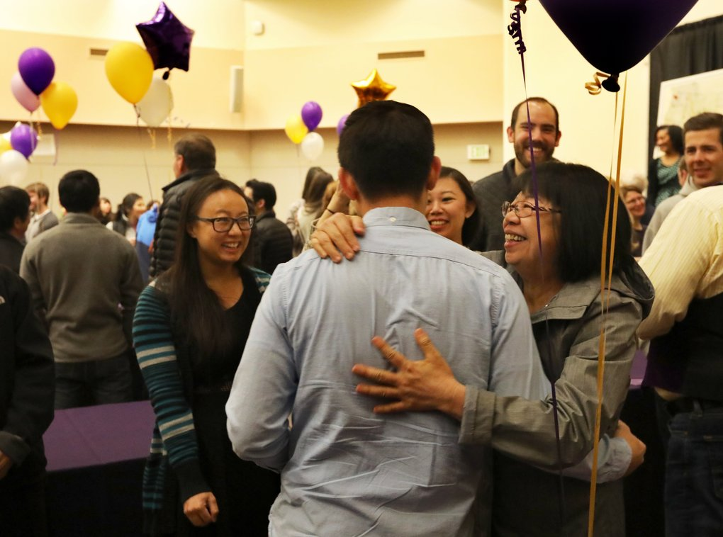 Proud mom Lien Ngo-Tran hugs her son Len Tran during the Match Day program at the University of Washington for graduating medical students finding out where they will doing their residency. Tran will be going to the University of New Mexico and studying emergency medicine.  (Alan Berner/The Seattle Times)