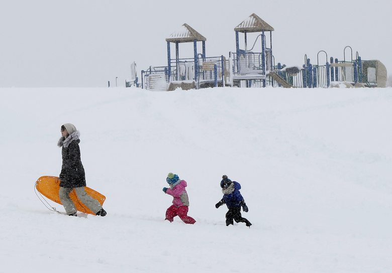 Christina Mesavage leads family friend, Una Mayer, center, and her son, Jude, up a sledding hill at the Eastern Promenade while enjoying the snow during a nor'easter Thursday, March 8, 2018, in Portland, Maine. Residents in the Northeast dug out from as much as 2 feet of wet, heavy snow Thursday, while utilities dealt with downed trees and power lines that snarled traffic and left hundreds of thousands of homes and businesses in the dark after two strong nor'easters – all with the possibility of another storm headed to the area. (AP Photo/Robert F. Bukaty)