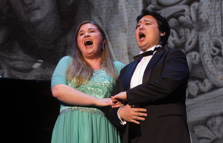 Soprano Chiara Isotton (l) and tenor Jaeheui Kwon perform at the 26th Annual Meeting of Shareholders, with more than 3,500 shareholders, employees, guests and board members, Wednesday, March 21, 2018, in Seattle, WA.