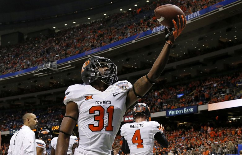 Oklahoma State safety Tre Flowers (31) warms up before the Sugar Bowl in 2016. (Jonathan Bachman / AP)