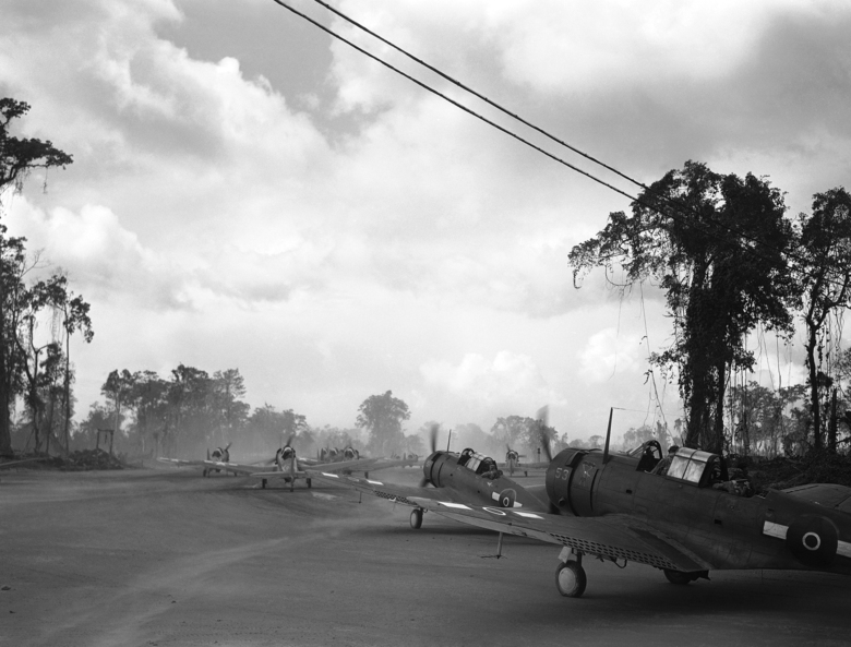 FILE – In this April 16, 1944, file photo, a combined force of American and Royal New Zealand Air Force dive bombers taxi to a runway on the island of Bougainville in Papua New Guinea. The island is where American fighters shot down Admiral Isoroku Yamamoto, the mastermind of the Pearl Harbor attack, making the wreck site one of most important of World War II. Now, 75 years later, a group from the U.S. and Japan is trekking to the remote Pacific island to document the site. (AP Photo/Frank Filan, File)