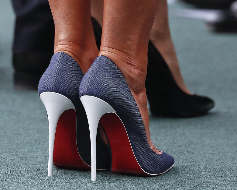 First lady Melania Trump wears red, white and blue shoes during a State Arrival Ceremony on the South Lawn of the White House in Washington, Tuesday, April 24, 2018. (AP Photo/Pablo Martinez Monsivais)