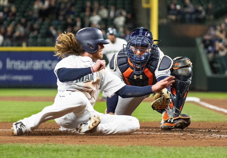Houston catcher Brian McCann tags the Mariners' Ben Gamel out at home in the second inning after Gamel tried to score from second base on a liner.  (Dean Rutz/The Seattle Times)
