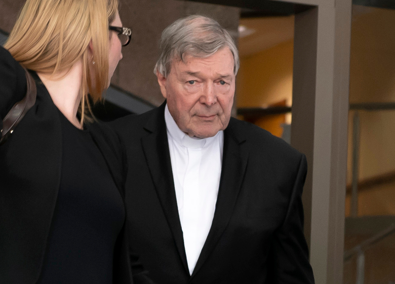 Australian Cardinal George Pell leaves the Melbourne Magistrate Court in Melbourne Tuesday, May 1, 2018. Australian Cardinal Pell, the most senior Vatican official to be charged in the Catholic Church sex abuse crisis, must stand trial on charges that he sexually abused multiple victims decades ago, a magistrate ruled Tuesday. (AP Photo/Andy Brownbill)