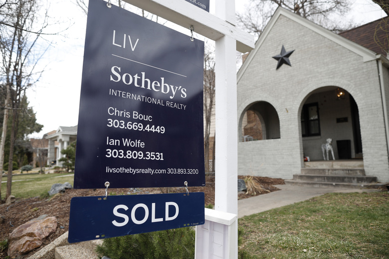 In this Wednesday, March 28, 2018, photo a sold sign is shown outside a single-family home on the market in Denver. On Thursday, April 5, Freddie Mac reports on this week's average U.S. mortgage rates.  (AP Photo/David Zalubowski)