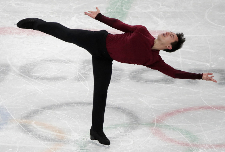 FILE – In this Feb. 17, 2018, file photo, Patrick Chan, of Canada, performs during the men's free figure skating final in the Gangneung Ice Arena at the 2018 Winter Olympics in Gangneung, South Korea. Chan, who won his long-awaited Olympic gold as part of the team event at the Pyeongchang Olympics, is retiring  after more than a decade on the world stage. Chan made his decision official Monday, April 16, 2018, after alluding to it during the Winter Games. (AP Photo/Julie Jacobson, File)