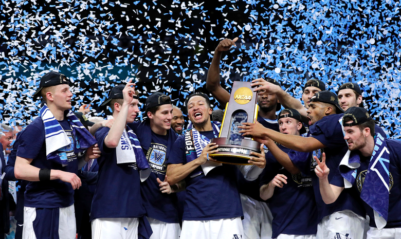 Villanova players celebrate their NCAA title, which came at the end of 36-4 season and six NCAA tournament games in which they won each by double-digits.  (David J. Phillip/AP)