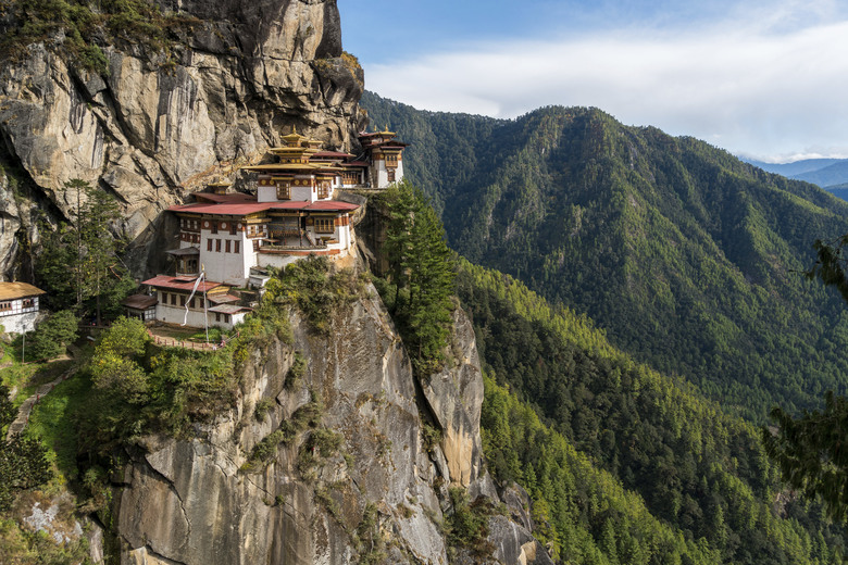 The iconic Tiger's Nest Monastery, or Taktshang Goemba, perches on a steep cliff about 2,700 feet above Paro, in Bhutan. The most famous of the small nation's monasteries, the holy place was originally built in 1692.  (Alexandra Reynolds/AP)