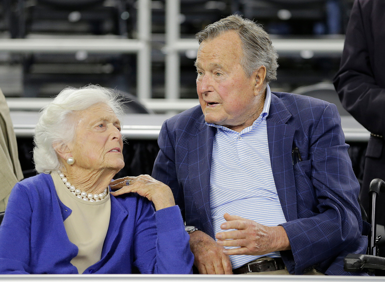 "FILE – In this March 29, 2015, file photo, former President George H.W. Bush and his wife Barbara Bush, left, speak before a college basketball regional final game between Gonzaga and Duke, in the NCAA basketball tournament in Houston. A family spokesman said Sunday, April 15, 2018, that the former first lady Barbara Bush is in ""failing health"" and won't seek additional medical treatment. (AP Photo/David J. Phillip, File)"