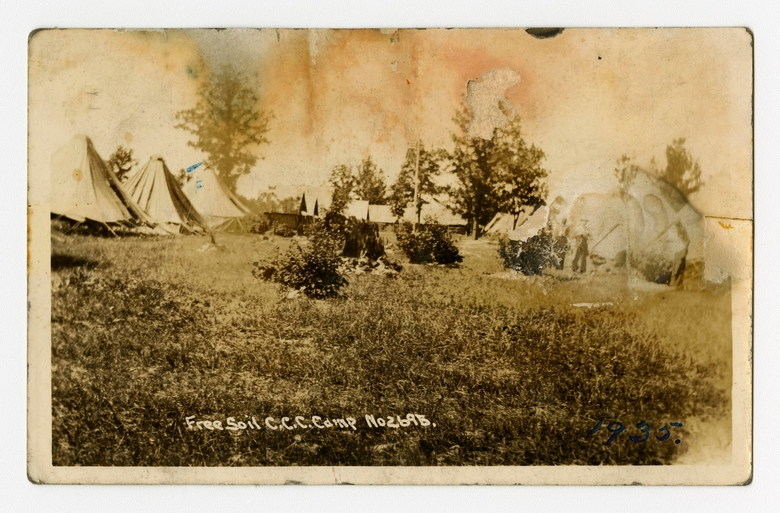 "In a photo provided by the Bentley Historical Library, a view of tents and cabins of Free Soil Camp is seen in this undated photo. The university has acquired a trove of photos capturing a place and time largely overlooked by history: black Civilian Conservation Corps camps during the Great Depression. The photos are the only known images of the state's segregated, all-black camps. President Franklin Roosevelt established the corps in the early 1930s to employ a ""vast army"" of unemployed men and restore national resources. (Bentley Historical Library via AP)"