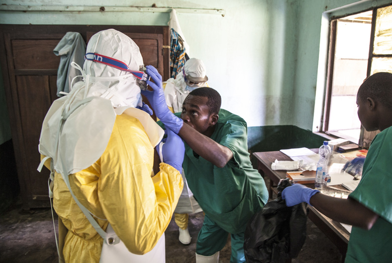 12 2018 health workers don protective clothing as they prepare to attend to patients in the isolation ward to diagnose and treat suspected Ebola patients at Bikoro Hospital in Bikoro the rural area where the Ebola out