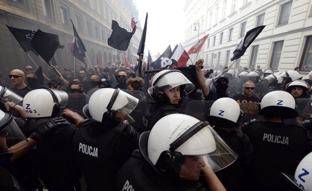 Police clash with supporters of the far-right National-Radical Camp, as they take part in a march to show their opposition to left-wing politics and the labor movement in Warsaw, Poland, Tuesday, May 1, 2018. (AP Photo/Czarek Sokolowski)