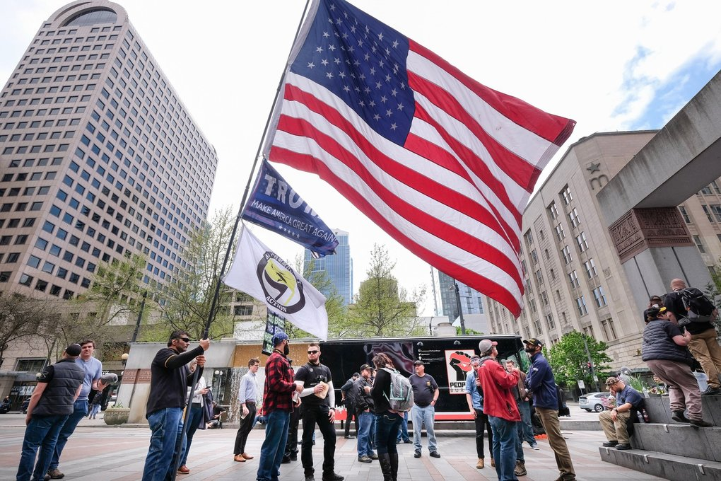 "A demonstration billed as ""Patriots for Prayer"" is held in Seattle's Westlake Park. May Day brought demonstrations and protests from a wide spectrum of interests.  (Dean Rutz / The Seattle Times)"