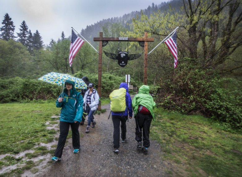 Hikers come and go at the entrance to the Chirico Trail on Tiger Mountain.  Final destination is Poo Poo point, a 3.8 mile round trip from parking lot where the Trailhead Direct bus drops off visitors from Seattle.  (Steve Ringman / The Seattle Times)
