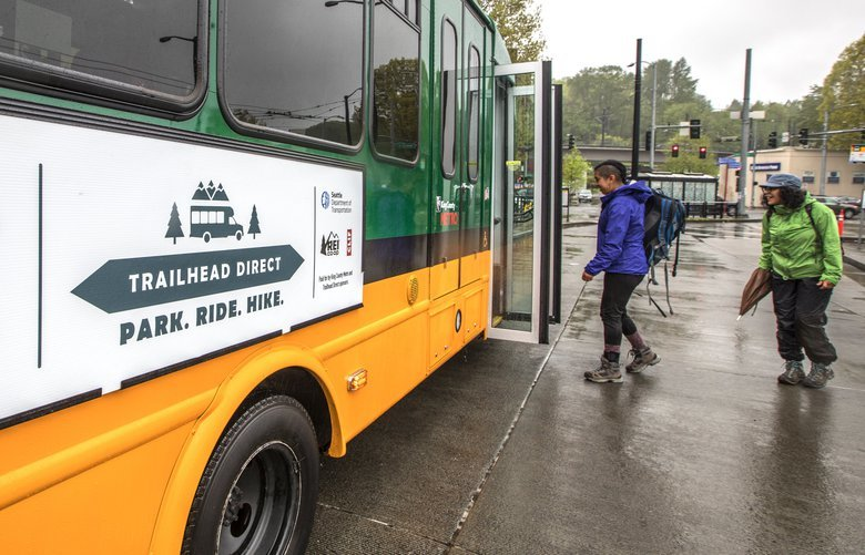 Saturday, April 28, 2018.   Hikers board the Trailhead Direct bus who are headed to Issaquah's Chirico's trail.    206135