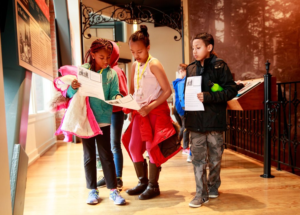 On a scavenger hunt, from left, are Amarah Ndirangu, Kalkadin Abebe and Pablo Nunez Canales. The fourth-graders from Seattle's Hawthorne Elementary were visiting Klondike Gold Rush National Historical Park. (Erika Schultz / The Seattle Times)