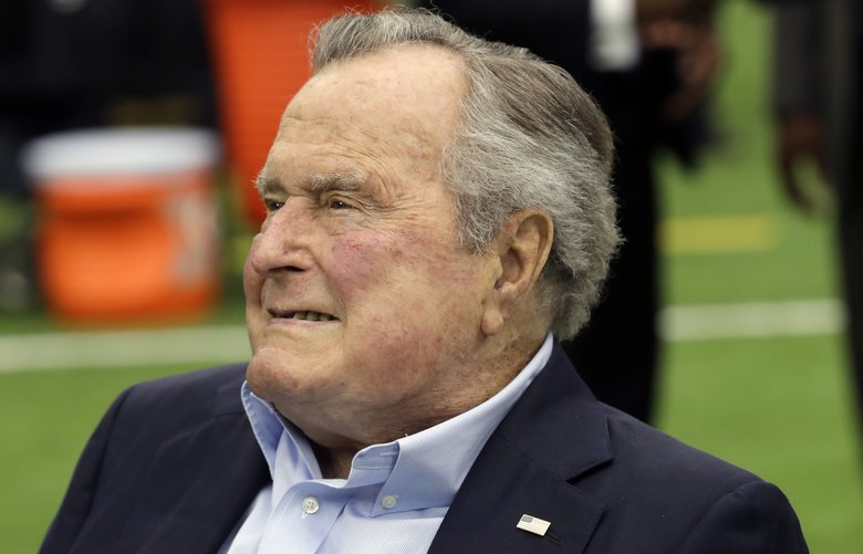 FILE- In this Nov. 5, 2017, file photo, former president George H.W. Bush arrives for an NFL football game between the Houston Texans and the Indianapolis Colts in Houston. A spokesman for the former president says the 93-year-old has been hospitalized for low blood pressure and fatigue. Spokesman Jim McGrath tweeted just after 2 p.m. Sunday, May 27, 2018, that Bush will likely remain in the hospital for a few days. (AP Photo/David J. Phillip, File) NYJK105 NYJK105
