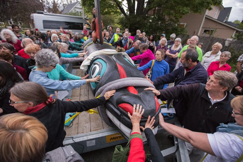 At an interfaith gathering in Bellingham on Wednesday, supporters of the orca totem-pole journey bless its start with a laying on of hands. The gathering was the beginning of a journey to Miami, where the Lummi Nation seeks the release of Tokitae, a captive killer whale, to her home waters in Washington state. (Steve Ringman/The Seattle Times)