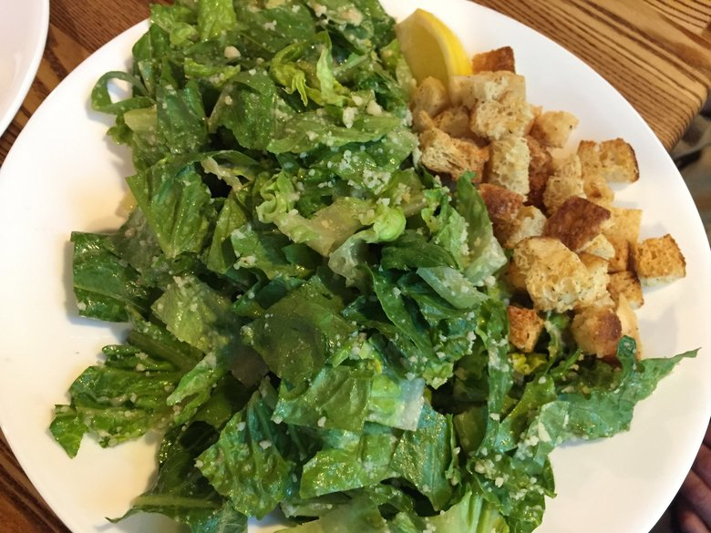 Breezy Town Pizza's Caesar salad is a simple, classic beauty.  (Bethany Jean Clement / The Seattle Times)