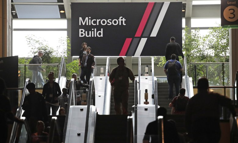 Attendees head in and out of Microsoft's annual Build conference for software developers. The three-day event at the Washington State Convention Center ended Wednesday. (Elaine Thompson / The Associated Press)