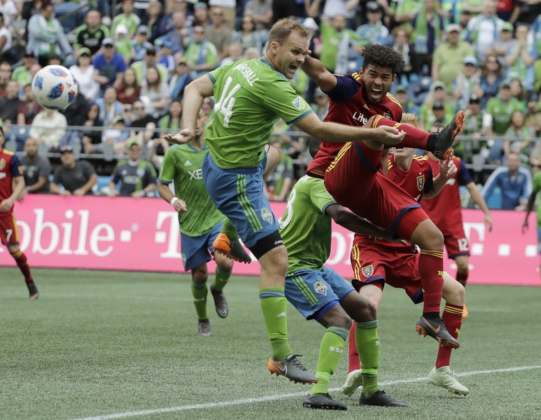 Sounders defender Chad Marshall, a candidate for MLS Defender of the Year, will not have to serve a suspension against Vancouver next week after his red card from last Saturday was rescinded. (AP Photo/Ted S. Warren) OTK OTK (Ted S. Warren / The Associated Press)