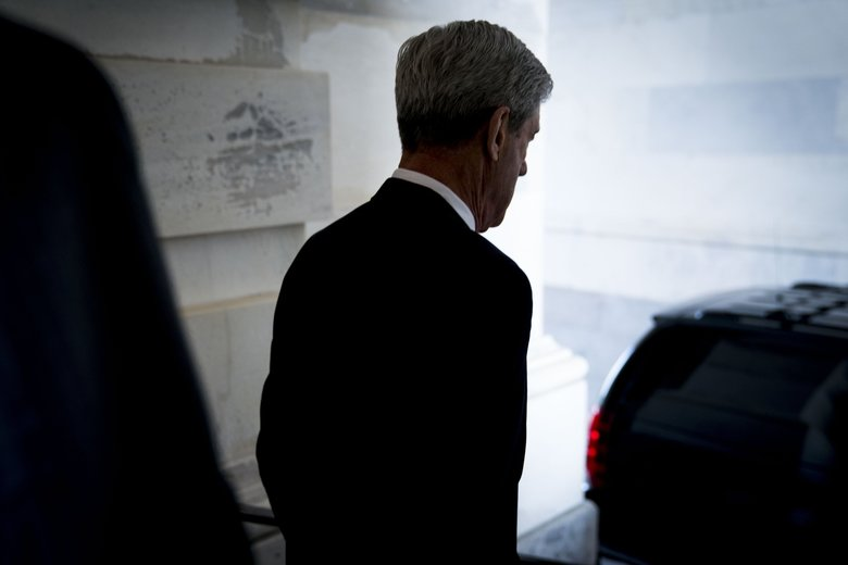 Robert Mueller, the special counsel overseeing the Russia investigation, reportedly told President Donald Trump's lawyers recently that prosecutors do not believe they can charge a sitting president with a crime under Justice Department guidelines.  (Doug Mills / The New York Times, file)