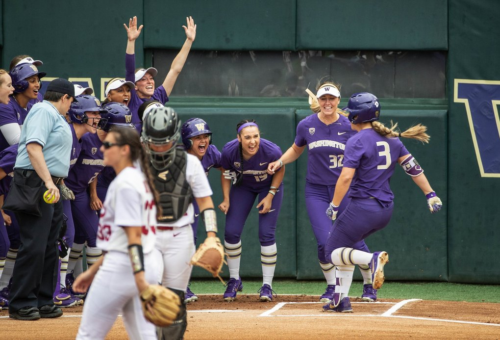 Washington gathers around home plate to welcome Taylor Van Zee whose leadoff homer gave the Huskies the only run they would need to defeat Alabama, and return to the College World Series.(Dean Rutz / The Seattle Times)