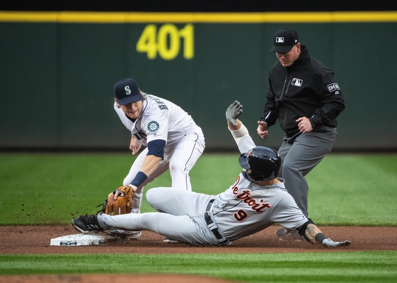 Seattle second baseman Gordon Beckham puts the tag on Detroit's Nicholas Castellanos who doubles in the 1st inning. Seattle challenged the play thinking Castellanos has come off the bag sliding, but the play was upheld on review.  (Dean Rutz/The Seattle Times)
