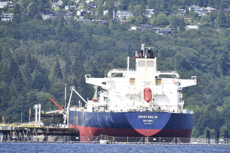 An oil tanker is seen at Kinder Morgan's Trans Mountain marine terminal, in Burnaby, British Columbia, on Tuesday, May 29, 2018. The federal Liberal government is spending $4.5 billion to buy Trans Mountain and all of Kinder Morgan Canada's core assets, Finance Minister Bill Morneau said Tuesday as he unveiled the government's long-awaited, big-budget strategy to save the plan to expand the oil pipeline. (Jonathan Hayward/The Canadian Press via AP)