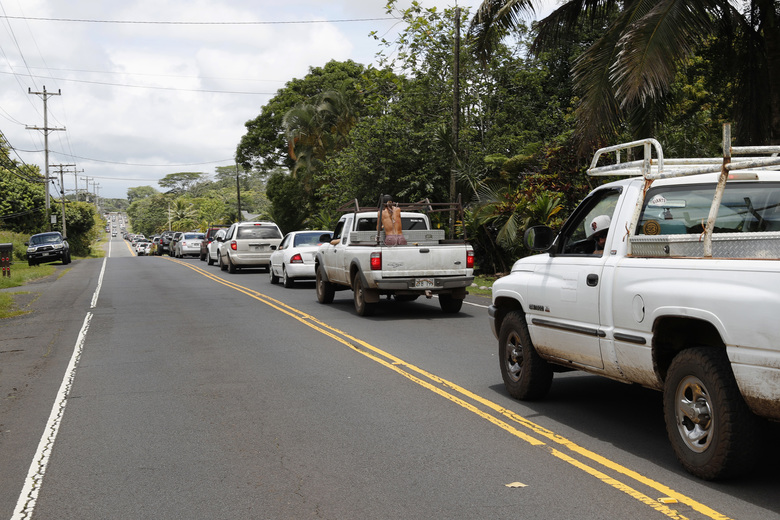 A line of traffic is seen going towards Pahoa town, Sunday, May 6, 2018, near Pahoa, Hawaii. Scientists reported lava spewing more than 200 feet (61 meters) into the air in Hawaii's recent Kilauea volcanic eruption, and some of the more than 1,700 people who evacuated prepared for the possibility they may not return for quite some time. (AP Photo/Marco Garcia)