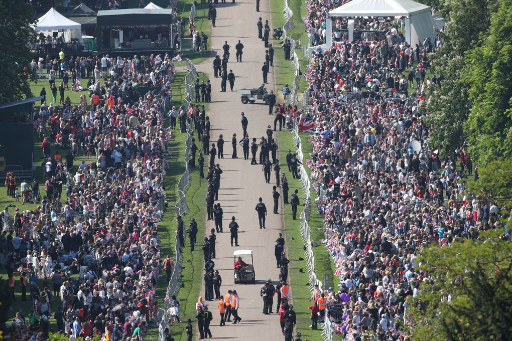 Spectators gather along the Long Walk ahead of the wedding of Prince Harry and Meghan Markle at Windsor castle in Windsor near London, England, Saturday May 19, 2018.  (Yui Mok/PA via AP)