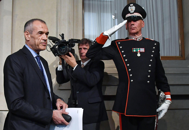 New premier-designate Carlo Cottarelli arrives to address the media after meeting with Italian President Sergio Mattarella, at the Quirinale Presidential Palace, in Rome, Monday, May 28, 2018. Italy's president has formally asked economist Cottarelli to try to form a government after quashing the hopes of the euroskeptic 5-Star Movement and the League to form Western Europe's first populist government. (Alessandro Di Meo/ANSA via AP)