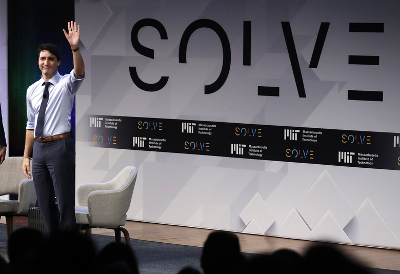 Prime Minister Justin Trudeau waves to the audience as he is introduced during the Massachusetts Institute of Technology's Solve conference at MIT in Cambridge, Mass., Friday, May 18, 2018. The Solve initiative connects innovators with corporate, government and academic resources to help them tackle world problems. (AP Photo/Charles Krupa)