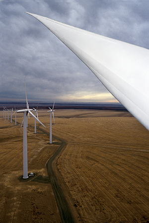 Wind turbines produce energy and some capacity, but their production fluctuates, and often are not at full output when the region's electricity consumption is highest.