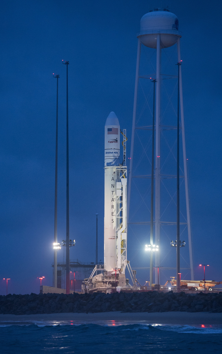 The Orbital ATK Antares rocket, with the Cygnus spacecraft onboard, is seen at launch Pad-0A, at sunrise Sunday, May 20, 2018 at Wallops Flight Facility in Virginia. The Antares will launch with the Cygnus spacecraft filled with 7,400 pounds of cargo for the International Space Station, including science experiments, crew supplies, and vehicle hardware. The mission is Orbital ATK's ninth contracted cargo delivery flight to ISS for NASA. (Aubrey Gemignani/NASA via AP)