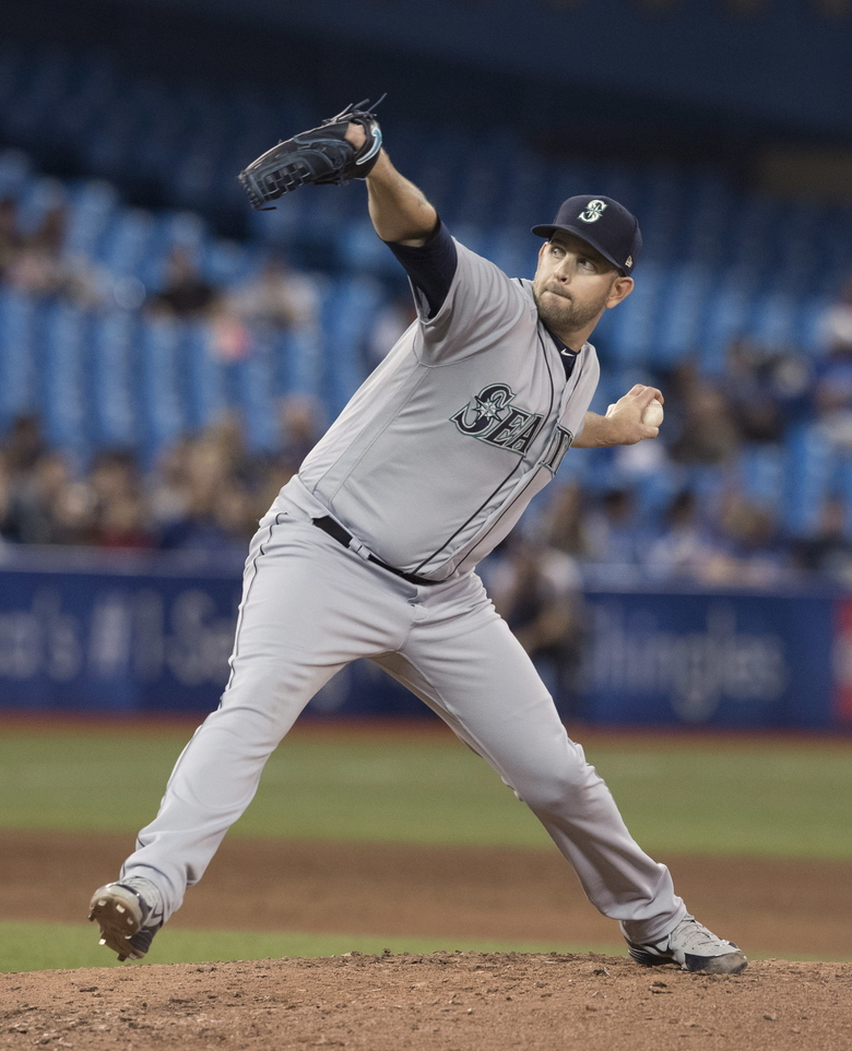 Pitcher James Paxton throws to a Toronto Blue Jays batter during the ninth inning. (Fred Thornhill/AP)