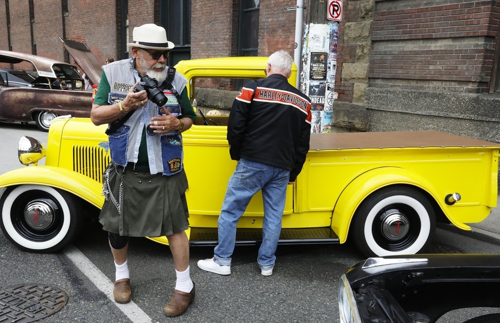 Car photographer Joel Chico Guevara, of Seattle, with a 1934 Ford pickup in the background, had a lot to cover at the 2018 Spring Opener, in Georgetown, on Sunday. (Ken Lambert/The Seattle Times)