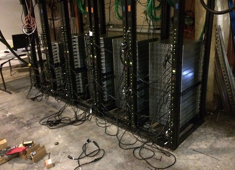 "The large amounts of electricity used by computer servers for cryptocurrency ""mining"" pose a growing challenge for utilities such as the Chelan County Public Utility District, to which miners are drawn by the cheap rates for power. This unauthorized setup in Cashmere was discovered in 2015.  (Chelan PUD)"
