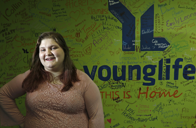 In this April 9, 2018 photo, Gabby Pratt poses for a photo at Quincy Young Life in Quincy, Ill.  The first time Pratt attended an event at Quincy Young Life, she spent most of it in the bathroom. Crippled by an anxiety attack, her first hour there was full of terror as she hid out in a stall. Pratt credits Young Life with helping her feel more comfortable and outgoing. Young Life is a faith-based ministry for students that provides them with social opportunities and connects them with counselors to speak with.(Jake Shane/The Quincy Herald-Whig via AP)