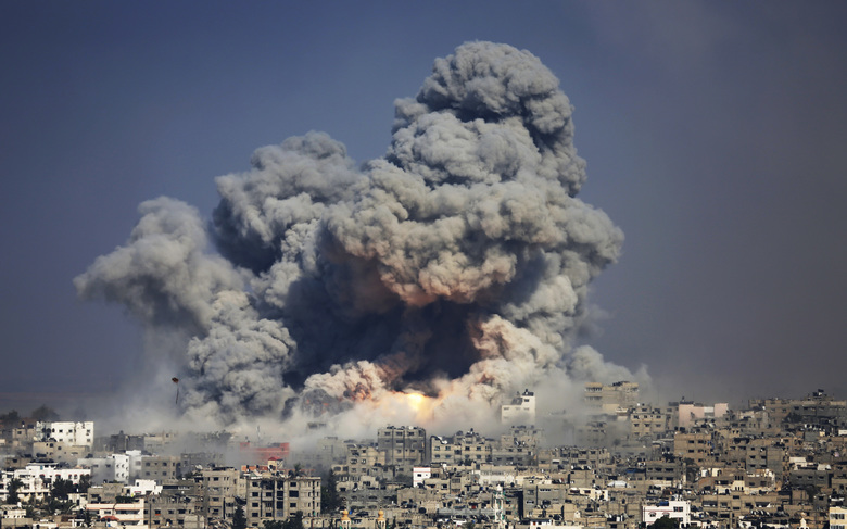 FILE – In this July 29, 2014, file photo, smoke and fire from an Israeli strike rise over Gaza City. The Gaza Strip, the focus of deadly demonstrations since March 2018, has been subjected to a stifling Israeli-Egyptian blockade. Coupled with violence between Israel and Gaza's Hamas rulers, the territory has become an ongoing crisis with no solution in sight. (AP Photo/Hatem Moussa, File)
